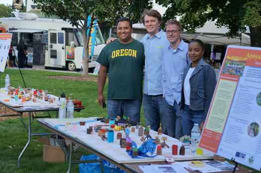 Medford, OR – Dr. Sandoval (left) and University of Oregon graduate students at the 2014 Multicultural Fair.