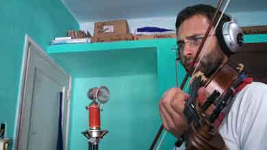 CLLAS graduate grantee Charlie Hankin, a music major, recorded violin tracks for raperos in Havana while carrying out ethnographic research.