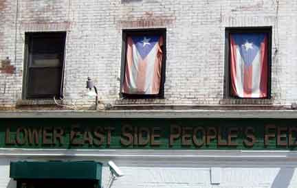 Puerto Rican flags on display in windows on the Lower East Side / courtesy Brandon Rigby.